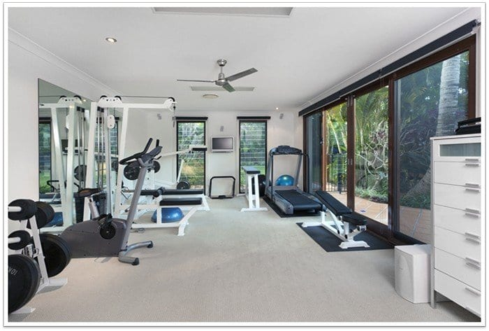 home gym with mirrors and sliding glass doors