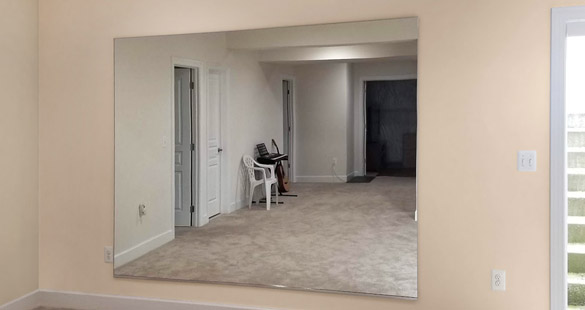 Example of J-channel glass gym mirror.